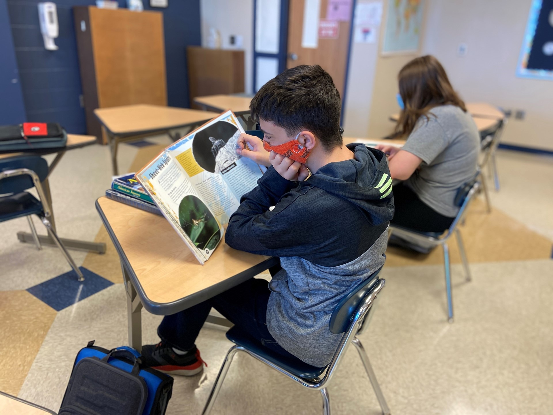 Student reads a textbook in class.