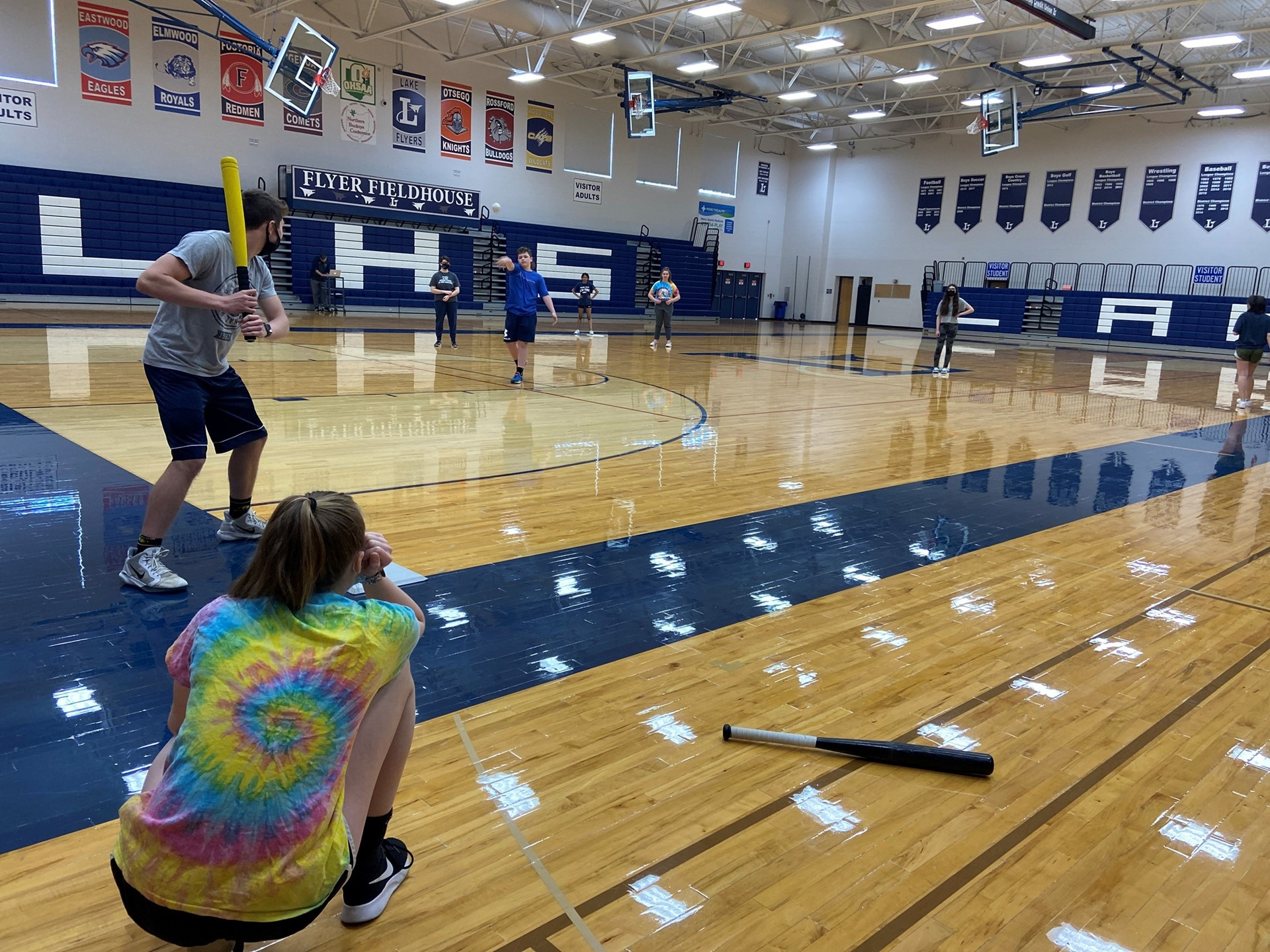 Students play baseball in Physical Education class.