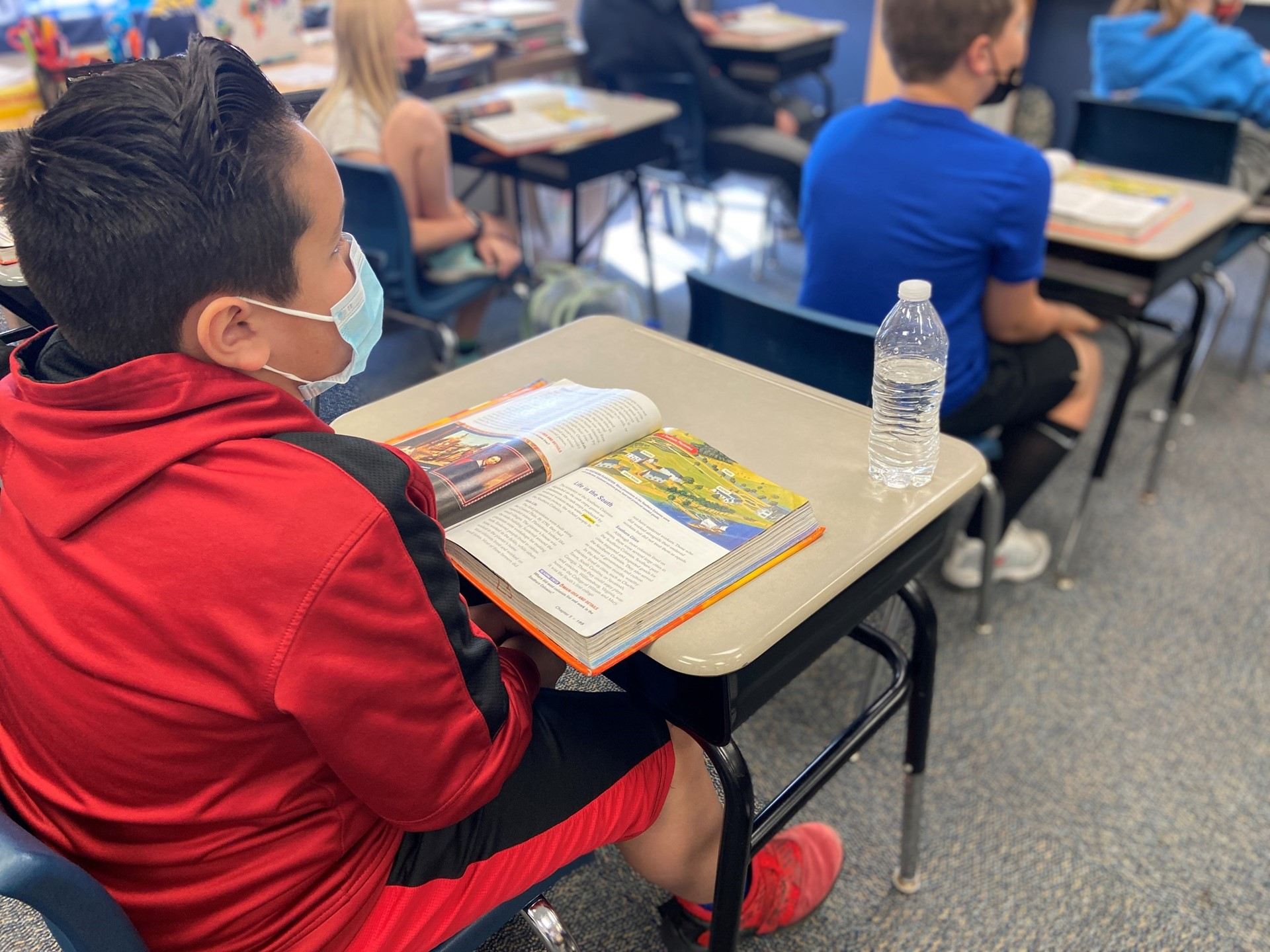 A student focuses on his social studies lesson.