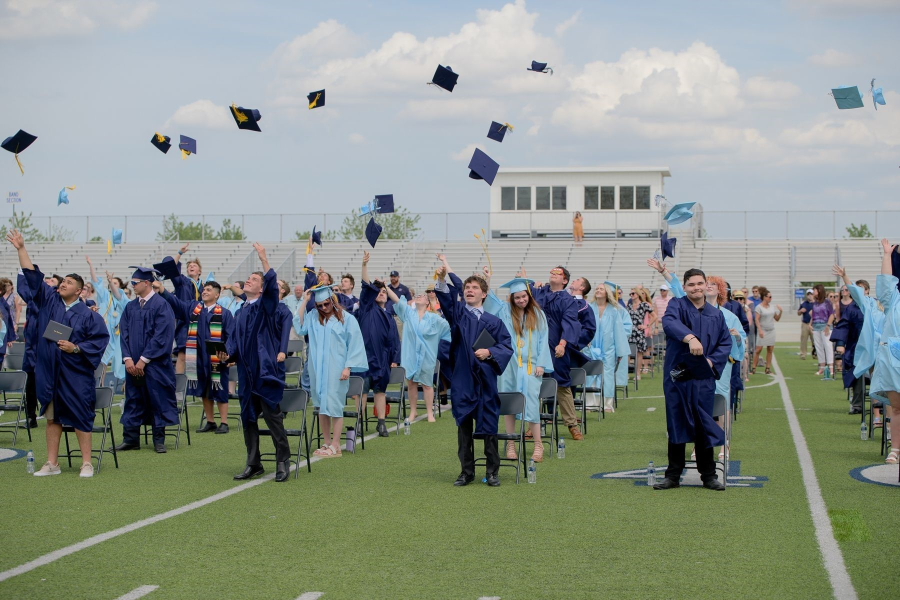 The Class of 2021 throw their graduation hats in the air at the end of the graduation ceremony.