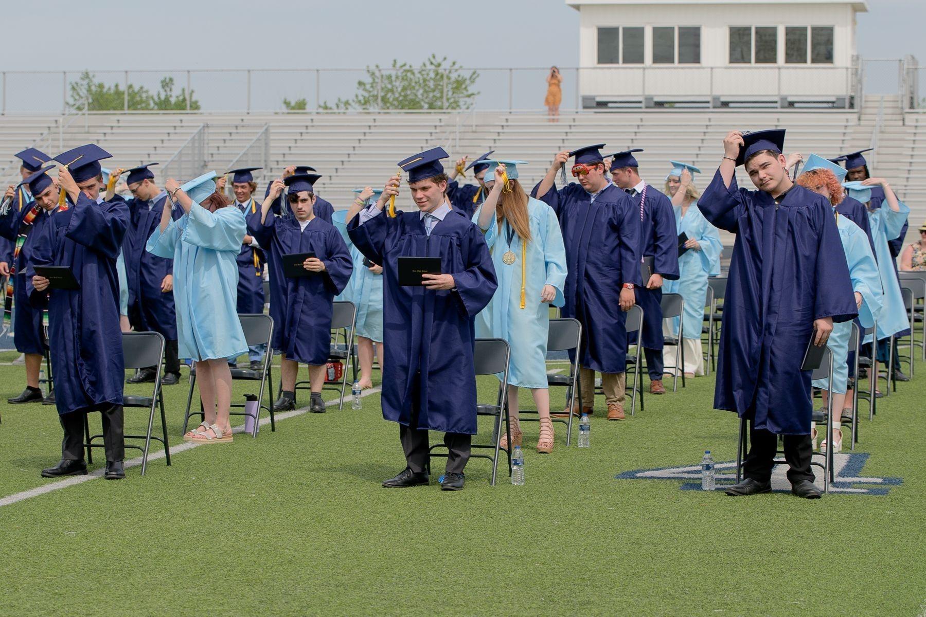 Graduates move their tassals.