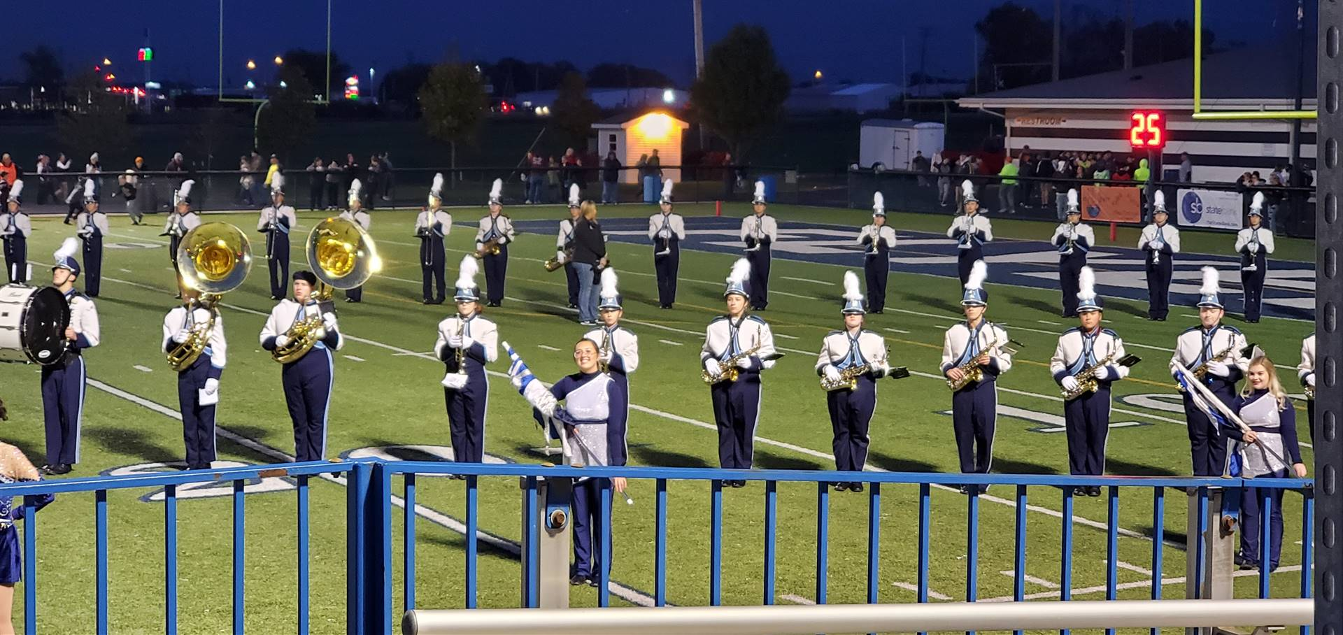 The Marching Band performing on the field on a Friday night.